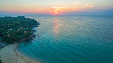 aerial view the sun going down to holison at Karon beach Phuket two jet boats sail in Karon sea during sunset