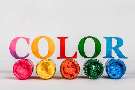 the colorful word color put on screen printing ink glass bottles in white background with copy space