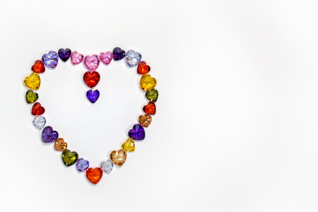 Colorful polished gemstones in heart shape on white background. heart of love design with colorful gemstone for valentine day