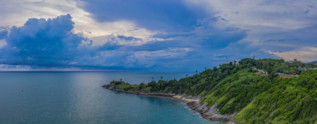 aerial view dark sunset at the rocky outcropping in the sea at Promthep cape. Promthep cape is the most popular viewpoint in Phuket. the most tourist always come to see sunset at this landmark