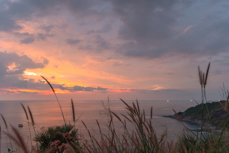 panorama sunset at Laem Promthep Cape. The landmark and popular viewpoint of Phuket Thailand. in every day a lot of tourists come here to watching sunset. Stok Fotoğraf - 112244195