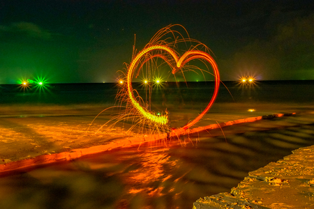 heart image from steel wool on the beach 写真素材
