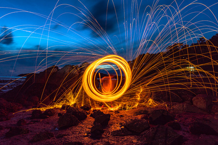Cool Burning Steel Wool Photo Experiments.burning steel wool spinning circle Fire at sunrise. Stok Fotoğraf