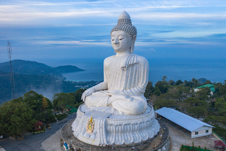 aerial photography scenery blue sky and blue ocean behind Phuket white big Buddha. Phuket white big Buddha is the famous landmark in Phuket island a lot of tourists visiting this landmark every day