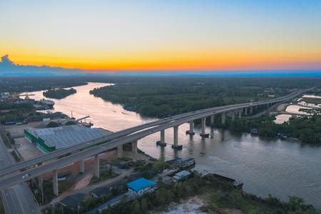 aerial photography sunset above Sri Surat bridge across Tapee river Surat Thani Thailand Reklamní fotografie