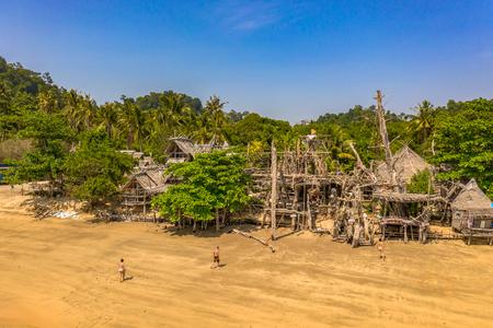 aerial photography above heaven beach at Buffalo Bay Phayam island Ranong Thailand. there have emerald green sea and perfect coral reef