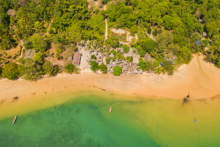aerial photography above heaven beach at Buffalo Bay Phayam island Ranong Thailand. there have emerald green sea and perfect coral reef