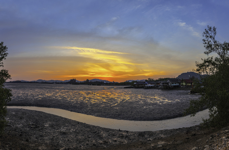 stunning sunset at fishing village in Phuket.during low tide will has a small canal beside fishing village Stok Fotoğraf