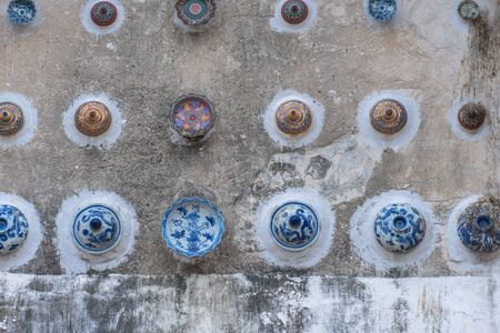 beautiful cups and bowls decorated on the wall of church at wat Ban Lang temple in Rayong province Thailand. the old church was built in Ayutthaya period