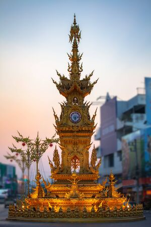 The beautiful clock tower in Chiang Rai square created by a famous Thai artist.  in the night there have Symphony of spectacular light colors and sound show