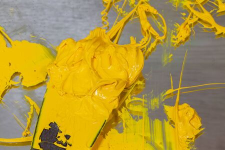 yellow color of ink for print tee shirt. Plastisol ink in white barrel are dripping. Plastisol ink useful for print tee shirt