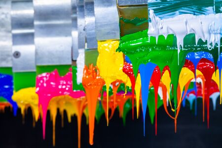 several dripping colors ink on handle printers in tee shirt factory hang on the storage 版權商用圖片