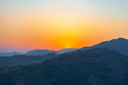 red sky sunset at Doi Chang Mub Chiang Rai on hill top border Thai and Myanmar 版權商用圖片