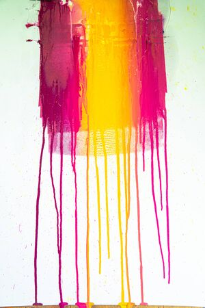 colors of printing ink purple, pink, orange, yellow and magenta colors are dripping on white paper.