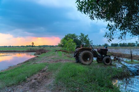 Farmers use tractors to pump water all day until the sun goes down.
