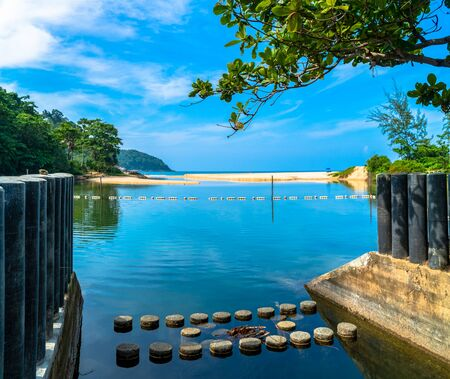 The water barrier to maintain the water level in the reservoir at the time of the sea level decreasing at Nai Harn Beach