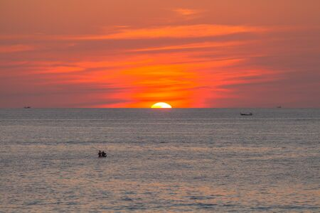 red sunset above the sea at Kata beach Phuket Thailand