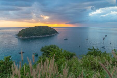 Man island in front of Promthep cape and wind turbine viewpoint. Promthep cape and wind turbine viewpoint are popular place in Phuket  Stok Fotoğraf