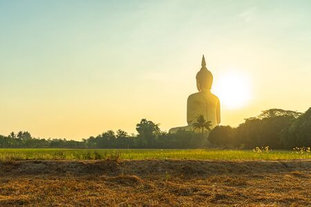 sunrise above the great Buddha of Thailand at wat Muang Ang Thong Thailand. 