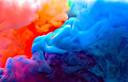 blue green yellow orange and pink colors melt in water