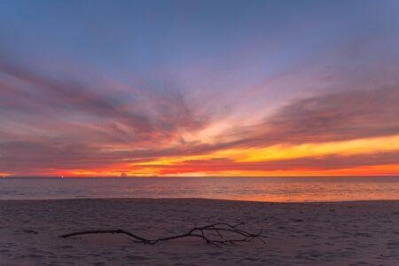 stunning red sky at sunset over the sea at Karon beach Phuket Thailand