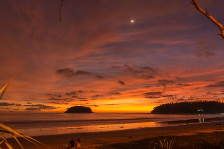 stunning cloud in sunset above Pu island Kata beach Phuket Thailand
