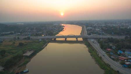 scenery sunset above Dechatiwong bridge across Chao Phraya river in Nakornsawan province Thailand