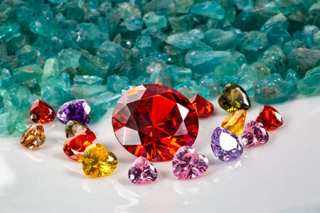 Ruby Red diamonds are placed in an enclave of heart shaped diamonds on raw sky blue gemstones.jewelry in heart shape are lovely present for valentine day