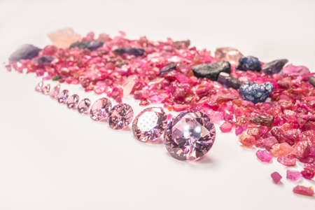 pink sapphires diamonds in different size in one row on white background 