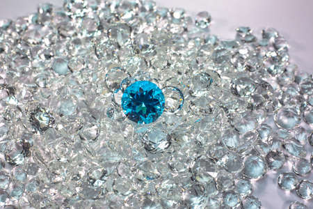 aquamarine diamonds are placed on a pile of white diamonds And keep turning.