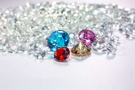colorful diamonds are placed on a pile of white diamonds And keep turning. video 4k resolution shoot in studio