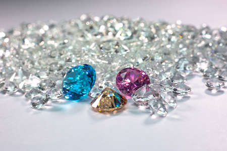 colorful diamonds are placed on a pile of white diamonds And keep turning.