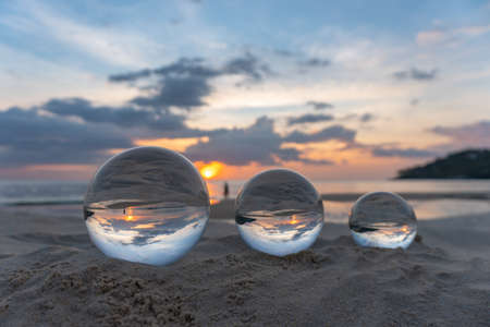 Three clear crystal balls of three sizes are sphere reveals  seascape view with spherical 