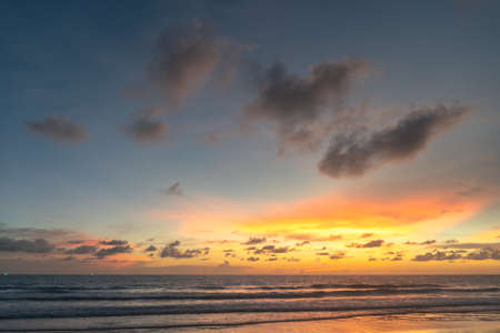 Majestic sunset or sunrise landscape Amazing light of nature cloudscape sky and Clouds moving away rolling Beautiful Phuket beach is a famous tourist destination in Andaman sea summer. colorful dark sunset clouds.