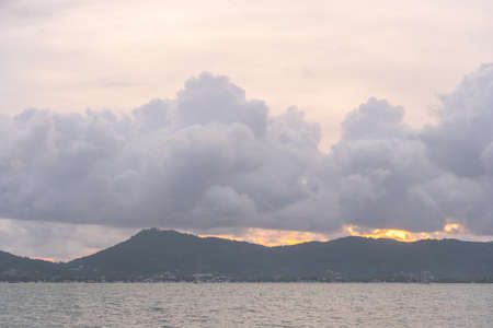 Scene of landscape views cloud moving above mountain range in summer day,nature rain cloud of nature cloudscape sky At Phuket big Buddha on the high mountain, Phuket,Thailand. Stock Photo