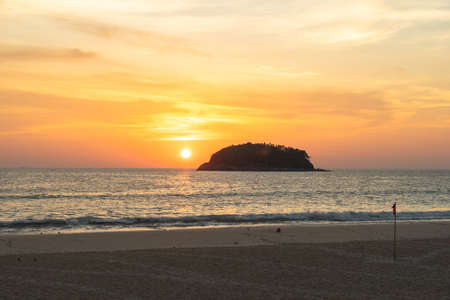 scenery yellow sky the sun going down to the sea.beautiful golden sky at sunset in Kata beach Phuket Thailandhigh quality image for travel concept.