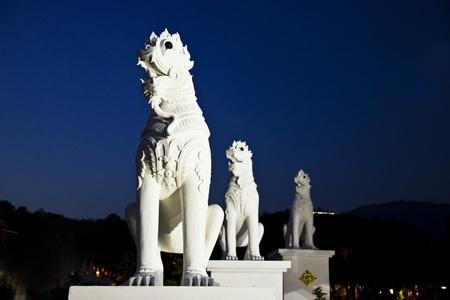 antique guardian lion sculpture temple, Thailand