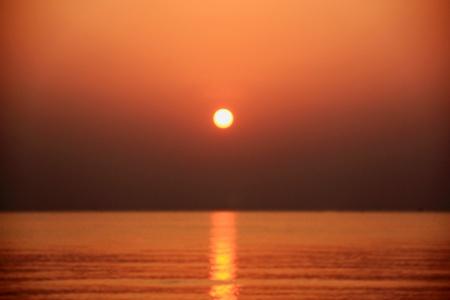 orange sun shines