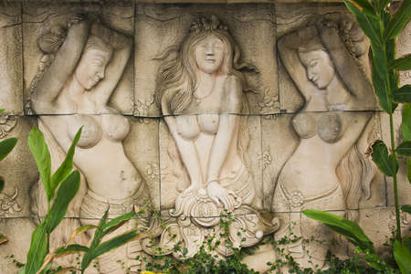 Sculptures on the wall of white brick  Stock Photo