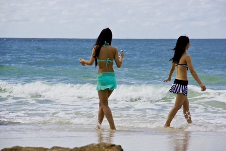Girl, beach, sea, and sky  Stock Photo - 17052155