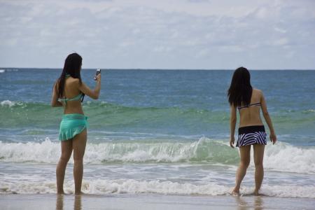 Girl, beach, sea, and sky Stock Photo - 17052132