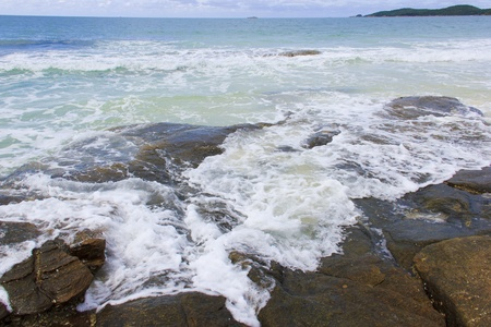 Beach waves with rock  Stock Photo - 17061296