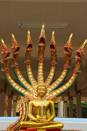 Buddha statue with dragon head Statue of Asian Art Stock Photo