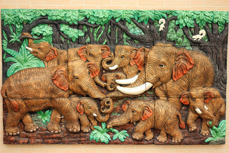 High relief carving of an elephant family. Stock Photo