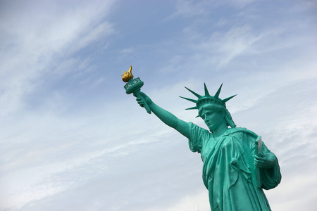 Statue of Liberty against a backdrop of blue sky.