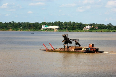 Boats carrying sand on the Mekong RiverThailand and Laos border
