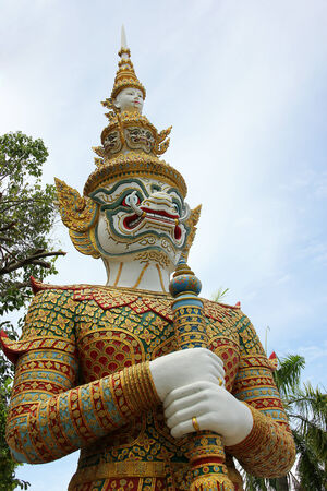 Giant statue in front of temple in Asia. Stock Photo