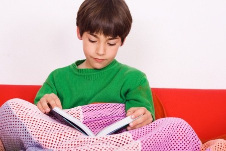 child reading on the couch  Stock Photo