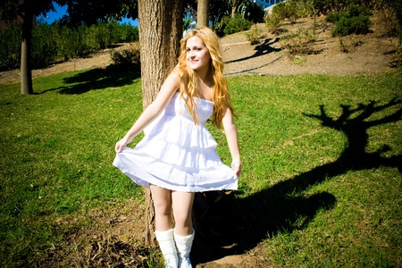 Happy woman with white dress in a natural environment