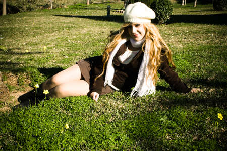 Young woman sitting on the grass relaxing